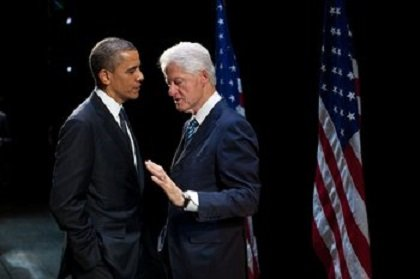 President Barack Obama talks with former President Bill Clinton backstage at the New Amsterdam Theater in New York on June 4, 2012.