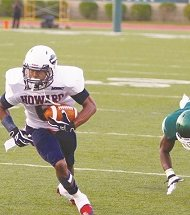 Howard wide receiver Jonathan Booker breaks a tackle en route to a touchdown. (Courtesy photo)