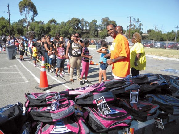 Students received free supplies, books, backpacks and haircuts at the Barack Obama Charter School.