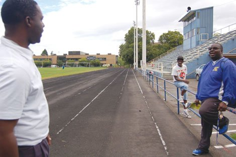 Marshall Haskins is excited about his new post as athletic director for Portland Public Schools. Less than a month into the position, Haskins has already proposed several ideas to raise the profile for a successful sports program that advances education as well.  Haskins (left) is pictured here taking a stroll along the Jefferson High School track and football field in north Portland where he is greeted by the school's wrestling coach, Montrial Brazzile (closest to the right) , and others.