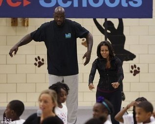 First lady Michelle Obama and former NBA star Shaquille O'Neal were among featured guests and speakers for a back-to-school event at Orr Elementary School in D.C. on Sept. 6.