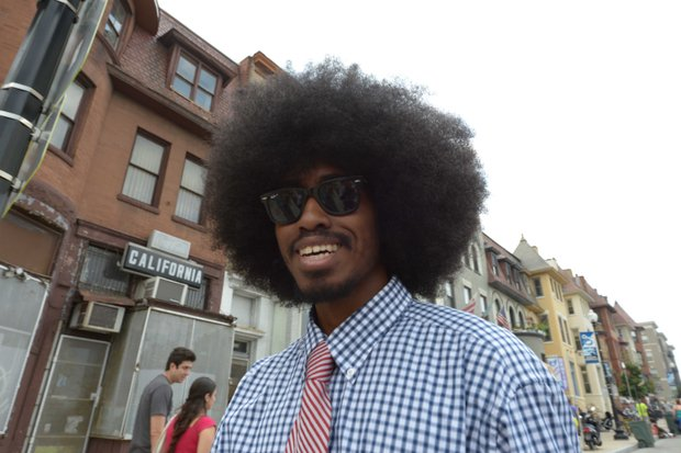 Jayrick Hayes, 26, sports an Afro during the 2013 Adams Morgan Day festivities in D.C. on Sunday, Sept. 8.