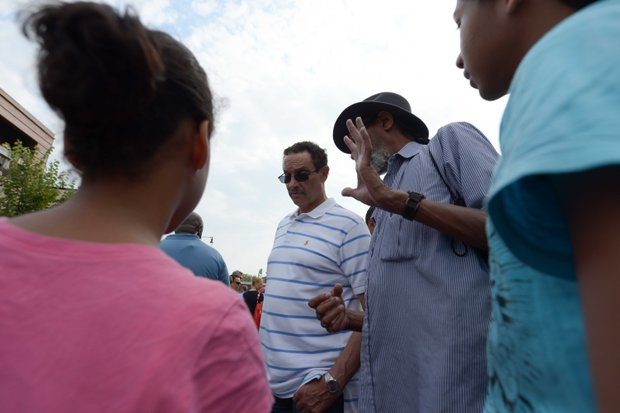 D.C. Mayor Vincent Gray talks with constituents at the 2013 Adams Morgan Day festivities on Sunday, Sept. 8.