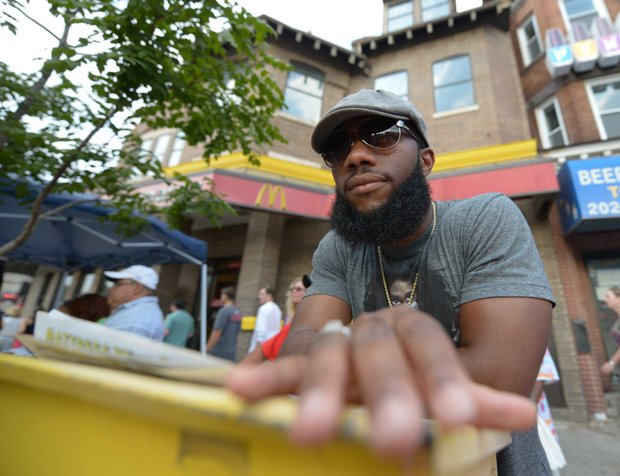 Nathan Manneh of Laurel, Md., poses for a portrait at Adams Morgan Day in D.C. on Sunday, Sept. 8.