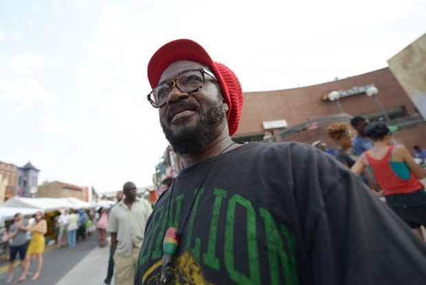 Kufi Asante enjoys live entertainment during the 2013 Adams Morgan Day festivities in D.C. on Sunday, Sept. 8.