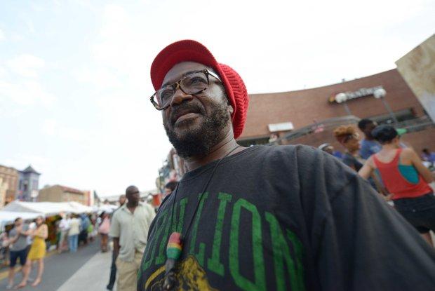 Kufi Asante enjoys live entertainment during the 2013 Adams Morgan Day festivities in D.C. on Sunday, Sept. 8.