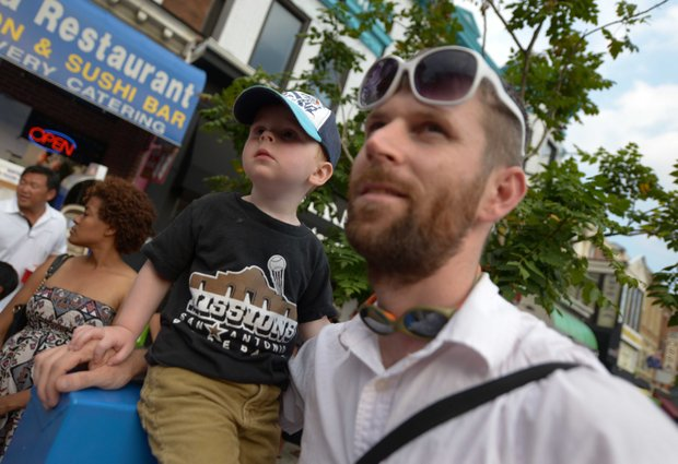 Oscar, 2, enjoys during the 2013 Adams Morgan Day festivities in D.C. on Sunday, Sept. 8., with his father Jeff Bortolet, 32.