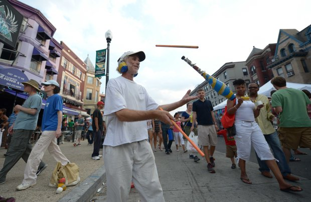 Juggler Dani AvRutick impresses the crowd with his juggling skills during the 2013 Adams Morgan Day festivities in D.C. on Sunday, Sept. 8.
