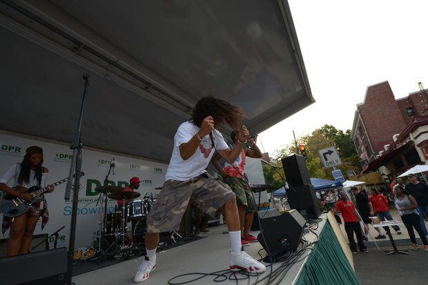 """Future band member Eddie """"EY"""" Young entertains the crowd during the 2013 Adams Morgan Day festivities in D.C. on Sunday, Sept. 8."""