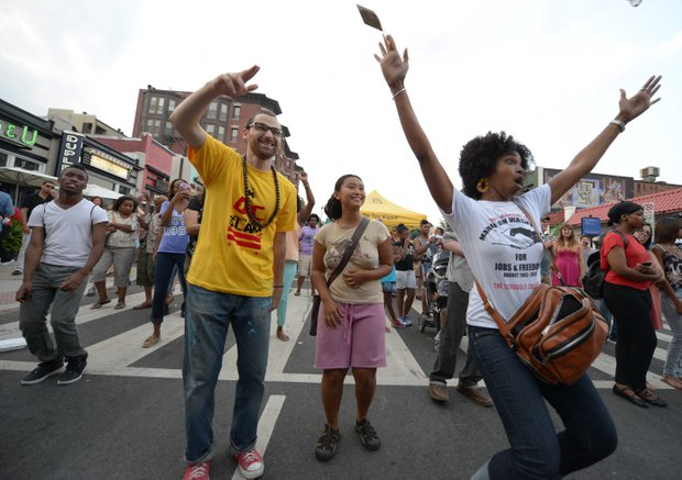 Revelers danced along 18th Street in D.C. during the 2013 Adams Morgan Day festivities on Sunday, Sept. 8.
