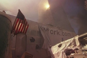 An American flag is seen amid the rubble on Sept. 11, 2011, following a terrorist attack on the World Trade Center in New York City. (Courtesy of loc.gov)