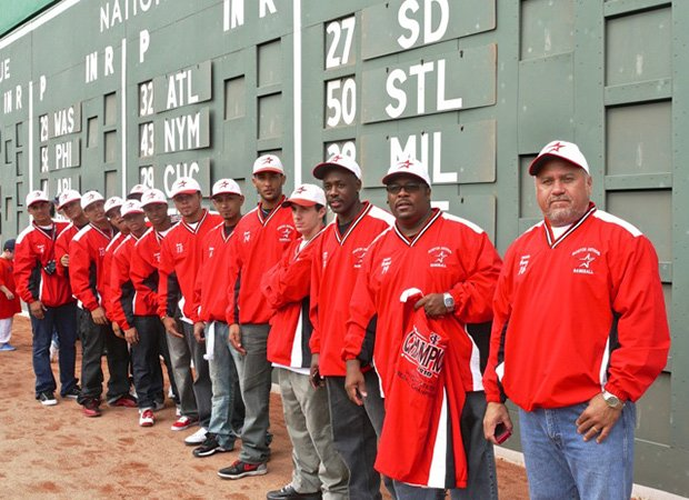 The Boston Astros work with many groups and organizations to support its inner-city baseball teams, including the Boston Red Sox. Boston Astros players and coaches are shown during a visit to Fenway Park.