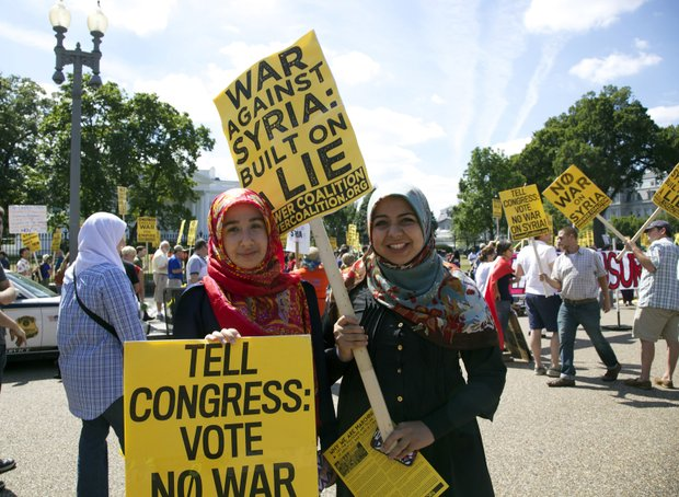 Maryland residents Donna Arefian and Sara Falam protest against U.S. military intervention in Syria at the White House.