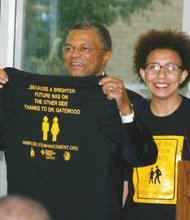 A former Jefferson High School Middle College student presents Dr. Algie Gatewood a commemorative T-shirt during a public farewell party for the Portland Community College leader.