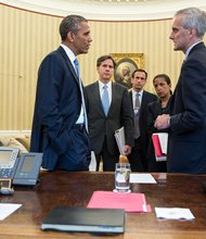 President Obama talks with advisers in the Oval Office on Sept. 10, 2013. Attendees include (from left) Tony Blinken, Deputy National Security Adviser; Phil Gordon, White House Coordinator for the Middle East, North Africa, and the Gulf Region; National Security Adviser Susan E. Rice; and Chief of Staff Denis McDonough. (Pete Souza/White House)