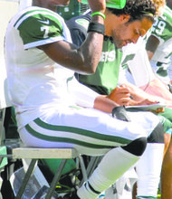 Geno Smith and Mark Sanchez proved working together works.