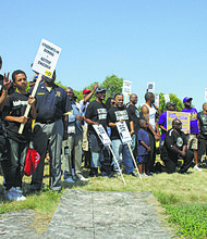 Fathers posing at the Million Father March with their signs