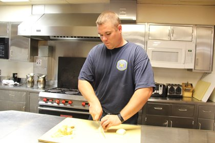 "Howard County Firefighter Kevin Weisenborn has become used to cooking for the group of guys he describes as ""10 very ..."