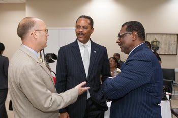 Harry D. Sewell, DCHFA Executive Director (center) talks with DCHFA board members Craig Pascal (left) and Stan Washington (right) at the official launch of DC Open Doors – Your Key to the City. (Chris Spielmann)