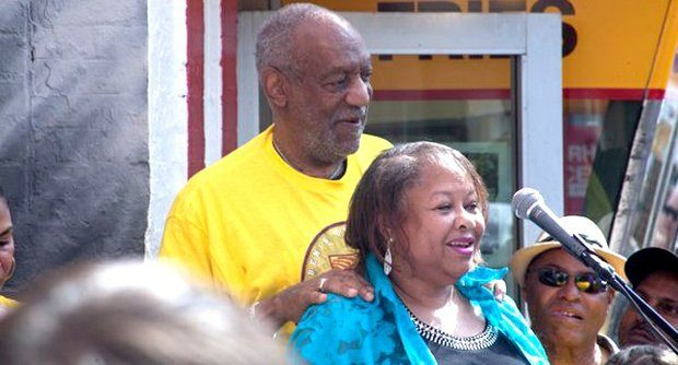 Jacqui Collins, a friend and customer of Ben's Chili Bowl for over 50 years, describes her loyalty to the restaurant, standing with Bill Cosby, one of the restaurant's most famous customers and emcee for the celebration of Ben's 55th Anniversary Celebration in Northwest on Aug. 22