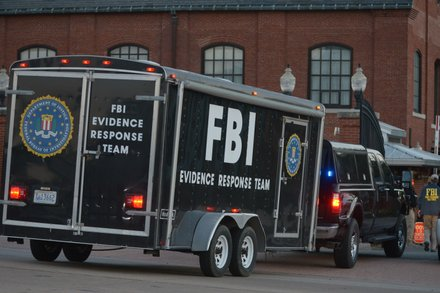 A FBI Evidence Response Team trailer passes through the Washington Navy Yard's M Street entrance in Southeast on Monday, Sept. 16, after a gunman went on a rampage, killing 12 people.