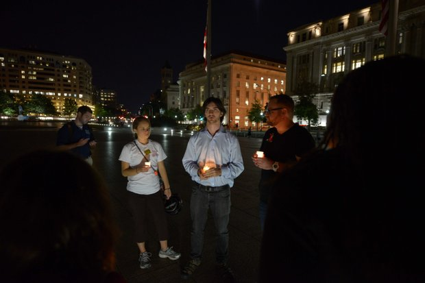 A small crowd gathered for a candlelight vigil at Freedom Plaza in Northwest on Monday, Sept. 16, to honor the victims of the Washington Navy Yard shooting.