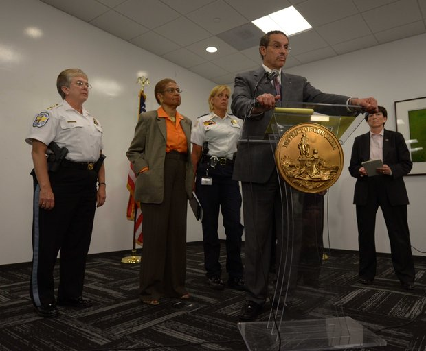 D.C. Mayor Vincent Gray (center) speaks during a press briefing for the Washington Navy Yard shooting on Monday, Sept. 16.