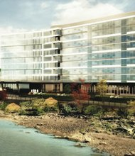 Daimler Trucks North America announced Friday it would build a new corporate headquarters on Swan Island in north Portland, bringing hundreds of jobs to the city. An artist's rendering shows what the building might look like along the banks of the Willamette River.