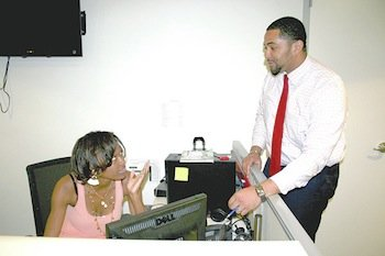 Gerren Price (right), associate director of the Department of Employment Services' Office of Youth Programs, talks to Lindsay Taylor, 19, of Northeast, a student at  the University of the District of Columbia. Taylor served as Price's assistant through the Summer Youth Employment Program.