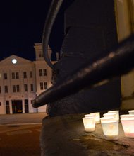 Candles sit on a window ledge facing the Washington Navy Yard before the start of a vigil for the victims of the Navy Yard shooting on Tuesday, Sept. 17. The vigil was hosted by Project End Gun Violence.