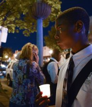 Derrick Hardy, 14, a student at the Richard Wright Public Charter School for Journalism and Media Arts in D.C., stands in silence during a candlelight vigil for the victims of the Washington Navy Yard shooting at 8th and M streets in Southeast on Tuesday, Sept. 17.