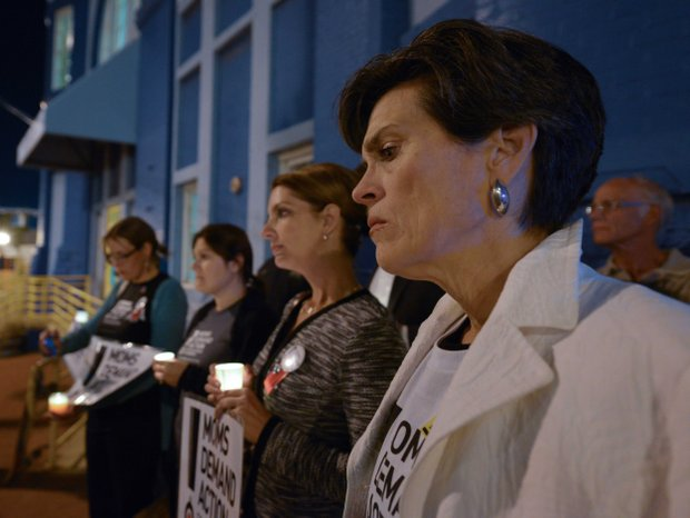Grace Terpstra, a member of Moms Demand Action, stands in silence during a candlelight vigil for the victims of the Washington Navy Yard shooting at 8th and M streets in Southeast on Tuesday, Sept. 17.