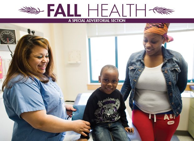A pediatric patient and his mother talk with a medical assistant at Codman Square Health Center.