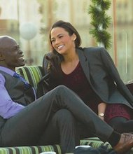 "Djimon Hounsou and Paula Patton star in ""Baggage Claim,"" a film written and directed by D.C. native David Talbert. (Courtesy of Fox Searchlight Pictures)"