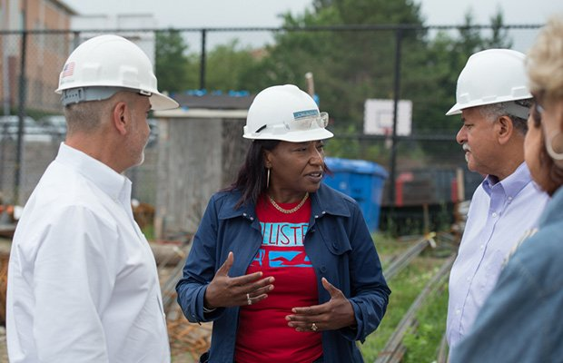 A photo at the Learning Center construction site (L-R): Jonathan Lavash, project manager of San Miguel Project Management; Cynthia Murchison, CWC Builder's community compliance and outreach coordinator; Wayne Ysaguirre, president and CEO of Associated Early Care and Education.