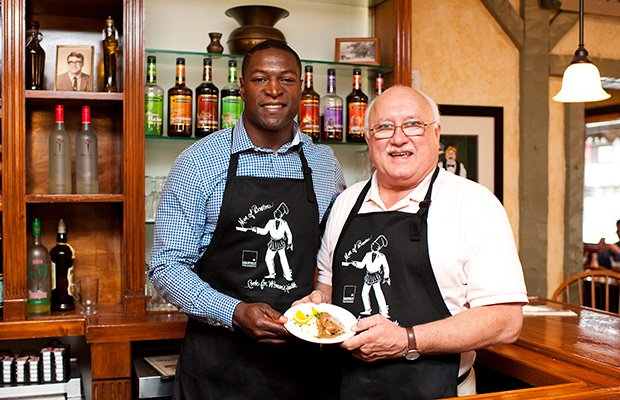 "Eric Alexander, New England Patriots Alumnus, and Gerard Adomunes, Owner of Gerard's Restaurant, present a small taste of the food that will be served by over 25 of Boston's finest restaurants and an illustrious lineup of celebrity chefs at Men of Boston Cook for Women's Health on Thursday, September 26th at 6pm at the Gala Tent in Codman Square. Proceeds benefit women's health programs at Codman Square Health Center. <a href= ""menofboston.org""> menofboston.org </a>"