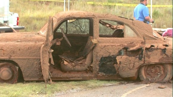 Two cars — rusted, caked with mud and carrying as many as six bodies — were pulled from the bottom of an Oklahoma lake Tuesday, September 17, 2013. Investigators say they believe one car may belong to a teenager who disappeared with two friends in 1970. The other car could be linked to the disappearance of a man in 1969, the stations reported.