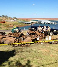 Oklahoma deputies pull bodies from a lake in Custer County, Oklahoma on September 18, 2013. The bodies may be from disappearances dating back to the 1960s and 1970s.