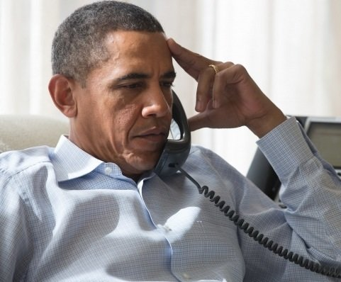 **FILE** President Obama speaks by phone with his national security staff regarding the situation in Egypt while in Chilmark, Mass., on Aug. 15, 2013. (Amanda Lucidon/The White House)