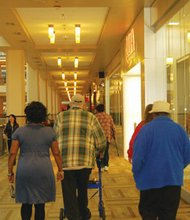 "A group of seniors take part in a Meals on Wheels program designed to keep elders active called ""Walk With Ease."" Led by the Urban League of Portland's Multicultural Senior Center Director Arleta Christian, the participants, all aged 60+, strolled the halls of Lloyd Center Mall as part of a 6-week effort to increase their health."