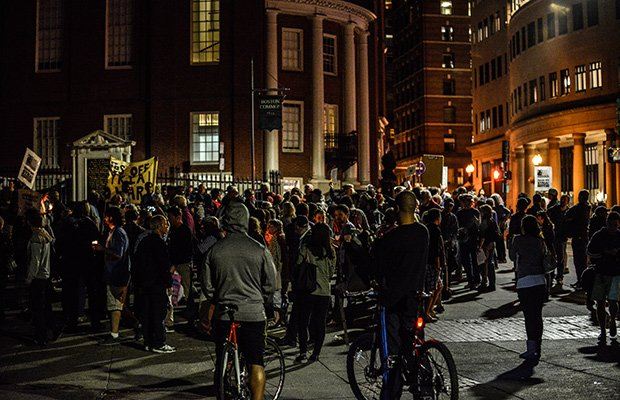 About 100 people gathered outside of Park Street station on the Boston Common in a candlelight vigil last week protesting possible U.S. military action against Syria.