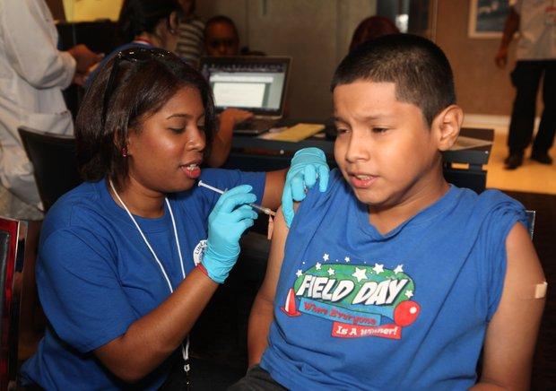A Lincoln nurse administers a vaccine.