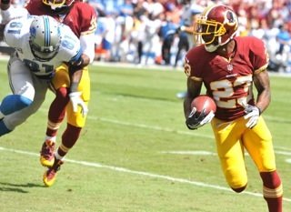 Washington Redskins CB DeAngelo Hall returns a first-quarter interception for a touchdown against the Detroit Lions on Sunday at FedEx Field.