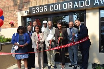 D.C. Council member Muriel Bowser (third from right), Ward 4 Democrat, participates in the ribbon-cutting ceremony in August for the Colorado Apartments in Northwest, which reopened this summer after a fire damaged the building four years ago. (Courtesy of the D.C. Housing Authority)
