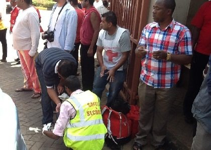 Hostages who were released from the Westgate Mall shooting and standoff in Nairobi, Kenya on September 21, 2013 are treated for injuries.
