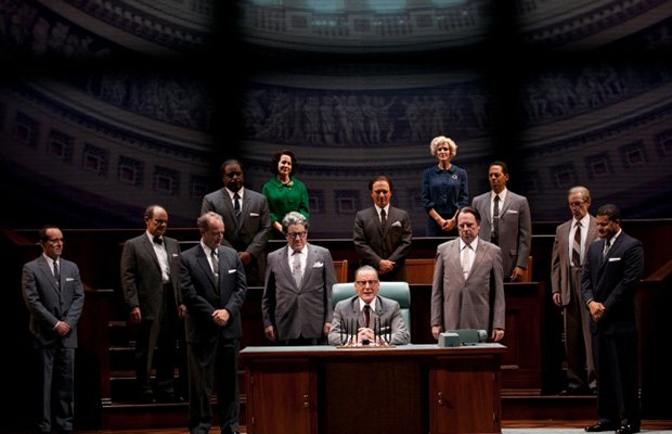 Bryan Cranston as President Lyndon Baines Johnson, surrounded by his staff.