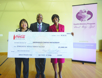 Maria Pajil Battle, president of the AmeriHealth Caritas Partnership, Curtis Etherly, director of Public Affairs and Communications at Coca-Cola Refreshments, and Karen Dale, executive director of AmeriHealth District of Columbia display the $25,000 donation from the Coca-Cola Foundation, which will go towards funding the health ministries program in D.C.