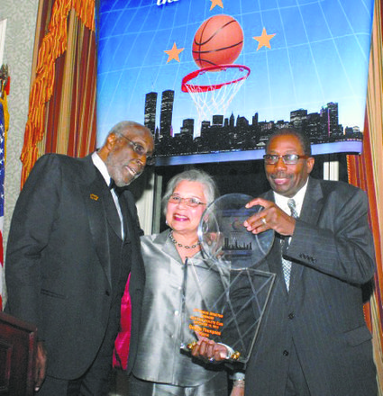 President Bob Williams, George Thompson and his wife celebrate his induction.