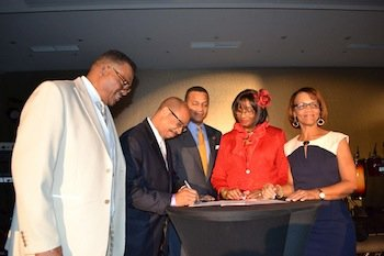 From left, Bobby Henry Sr., publisher of the Westside Gazette; John Rudley, president of Texas Southern University, NNPA Chairman Clovis Campbell; Dorris Ellis Robinson, publisher of the Houston Sun; and Jacqueline Hampton, publisher of Mississippi Link, attend the signing a Memorandum of Understanding for an internship program with Texas Southern University during a recent NNPA board meeting in D.C.