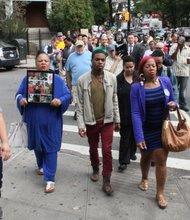 Family of victim left to die by police marches in Brooklyn